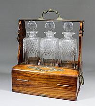 A late Victorian walnut and brass mounted three bottle Betjemann's Patent t