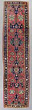 An Eastern runner woven in colours with a bold hooked pole medallion and fl