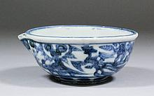 A Chinese blue and white porcelain circular pouring dish painted with a dra