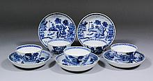 Five Chinese blue and white porcelain tea bowls and saucers painted with pa