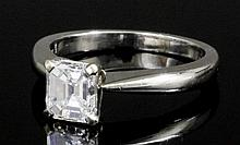 A modern platinum mounted diamond solitaire ring by David Morris, the emera