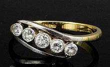 An early 20th Century 18ct gold and platinum mounted five stone diamond rin