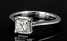 A modern 18ct white gold mounted diamond solitaire ring, the princess cut s