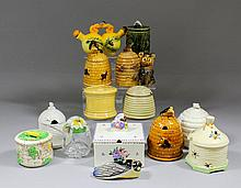 A small collection of ceramic honey pots and bee related items, including -
