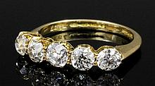 An Edwardian 18ct gold mounted five stone diamond ring, the old cut stones