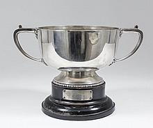 A George V silver circular two-handled trophy with angular handles, on circ