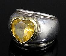 A modern Tiffany 18ct gold and silver mounted citrine set ring, the wide si