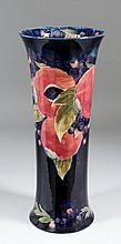 An impressive Moorcroft pottery cylindrical vase of waisted form, tube line