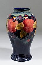 A Moorcroft pottery baluster shaped vase tube lined and decorated in colour