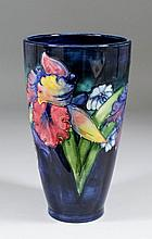 A Moorcroft pottery vase of tapering form, tube lined and decorated in colo