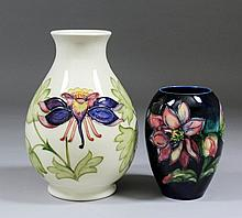 A Moorcroft pottery vase with flared rim, tube lined and decorated in colou