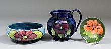 A Moorcroft pottery shallow bowl, tube lined and decorated in colours with