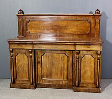 A Victorian mahogany sideboard with shaped panel to back, the base fitted t