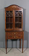 An Edwardian mahogany display cabinet inlaid with a basket of flowers, ribb