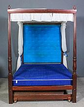 A modern mahogany 4ft 6ins four poster bedstead of Georgian design, with tu