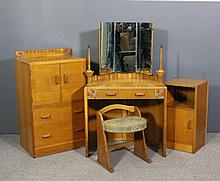 A 1950's child's light oak bedroom suite by Gomme furniture, High Wycombe,