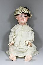 A late 19th/ early 20th Century German bisque headed baby doll, the bisque