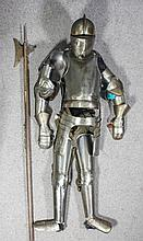 A 20th Century suit of armour designed and made by Henry Frederick Watts an