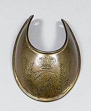 A George III gilt copper gorget of small size, engraved with crowned GR cip