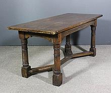 "An oak refectory table of ""17th Century"" design with cleated three plank to"