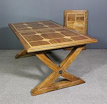 A modern inlaid hardwood rectangular extending refectory style dining table