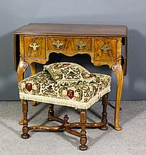 A walnut drop leaf dressing table of 18th Century design with moulded edge