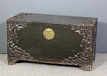 A 20th Century Chinese stained wood blanket chest carved with waterlilies a