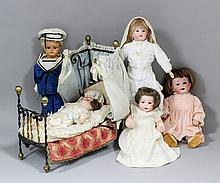 A small early 20th Century Heubach Koppeldorf bisque headed doll with compo