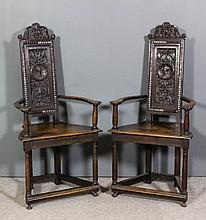 A pair of 19th Century carved and panelled oak armchairs of 16th Century Ca
