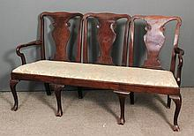 A walnut framed triple chair-back settee of George II design, the shaped cr
