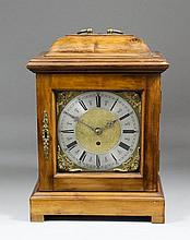 A 20th Century fruitwood cased mantel timepiece of early 18th Century desig