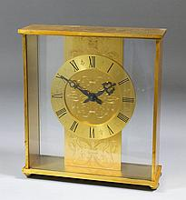 A 20th Century gilt brass cased mantel timepiece, the 5.25ins diameter chap