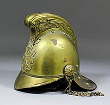 """A late 19th/ early 20th Century brass """"Merryweather"""" pattern fireman's helm"""