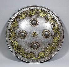 A good 19th Century Indo Persian circular steel shield, the surface with fo