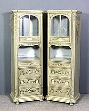 A pair of 19th Century French green painted cabinets with canted front corn