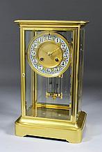 "A late 19th Century French gilt brass ""Four Glass"" mantel clock, No. 4692,"