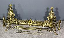 A late 19th Century French gilt brass adjustable fender comprising pair of