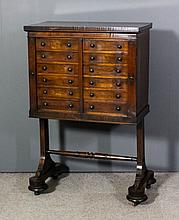 A Victorian rosewood twin specimen cabinet with square edge to top, fitted