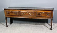 An 18th Century oak dresser base with one piece top, fitted three frieze dr