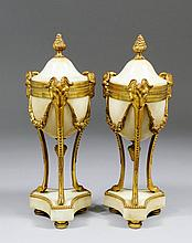 A pair of 20th Century Continental gilt brass and white marble covered urn
