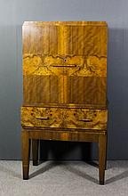 A 1930's walnut and figured walnut cocktail cabinet of Art Deco design, the