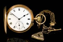 An early 20th Century gentleman's 9ct gold full hunting cased keyless lever pocket watch, No. 56890, the white enamelled dial with Roman numerals and subsidiary seconds dial, contained in plain 9ct full hunting cased 48mm diameter (gross weight 62 grammes), and a triple chain link Albert hung with T-bar, slides and charm, 200mm overall (gross weight 12.5 grammes) <br>Note : Metal unmarked but tests as gold