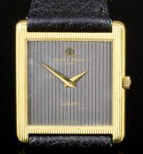 A modern gentleman's Baume & Mercier 18k gold cased quartz dress watch, the plain textured black dial in 18k gold moulded rectangular case, 28mm x 24mm (case No. 1739 011 and 1268132)