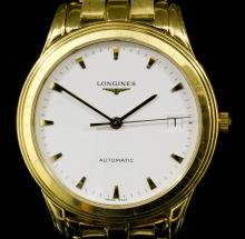 A 1980's gentleman's Longines 18K gold cased automatic wristwatch, the white finished dial with date aperture, numeral batons and sweep seconds hand, contained in 18k gold case (No. 28503747), 36mm diameter, with conforming 18k gold strap with Longines clasp (gross weight 99 grammes) <br>Note : The property of Mr Keith Hollands, Ex Formula I Racing Driver, who won the 1969 Madrid Grand Prix, and with copy of photograph of him racing