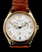 A 1990's gentleman's Patek Philippe 18K gold cased automatic calendar wristwatch,