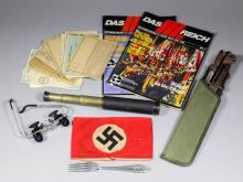A small collection of Second World War German Nazi miliaria items, including - Gestapo red cloth arm band, large jute sack stencilled with a Swastika, a bayonet, 14.5ins overall (lacking handle grips), a spike bayonet, 11.75ins, and a selection of identity cards, ration books and German magazines on the history of the Third Reich
