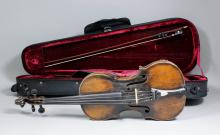 An English full size violin with two piece back (back excluding button 14ins) - 23.25ins overall - stamped in