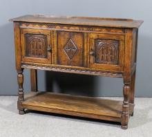 A panelled oak dresser base of