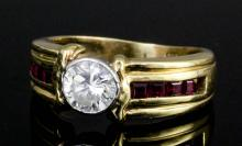 A modern 14ct gold ruby and diamond ring, the central brilliant cut diamond approximately .75ct in r