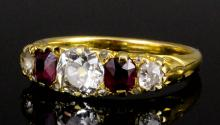 A late Victorian gold coloured metal mounted ruby and diamond five stone ring, the central old cut d